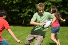 Teenagers playing rugby